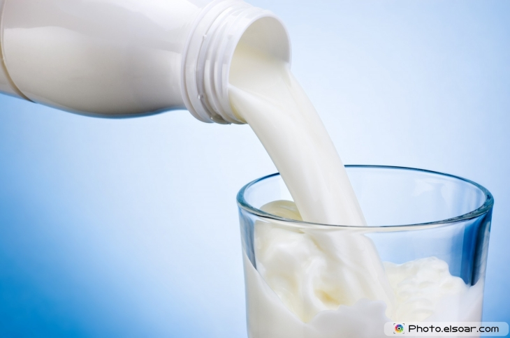 Pouring-milk-from-white-plastic-bottle-into-glass